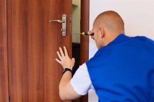Locksmith installing lock to timber door